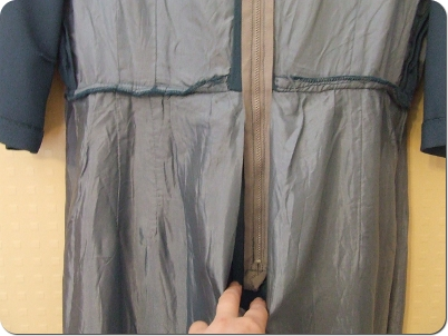 Skirt lining is separate from the skirt zipper. The separate sections are overlocked at the waist.