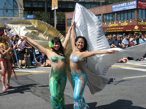 Rollerblading mermaids at the Coney Island Mermaid Parade, courtesy of Sameb.