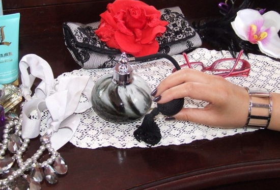 Lace, roses, perfume, and BonBon Rocher's hands