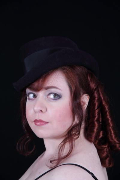 It's a darn shame my adorable black tilt hat doesn't show against the black background.